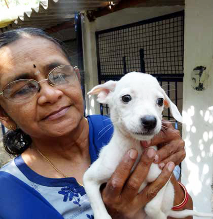 Ms. Mallika Buddhiraju VSPCA -woman_holding_dog_420