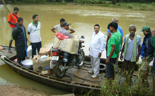 Our disaster response team traveled by boat to reach cyclone and flood victims.