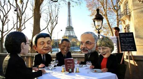 Activists wear masks depicting world leaders, including Prime Minister Narendra Modi, in Paris (2015)